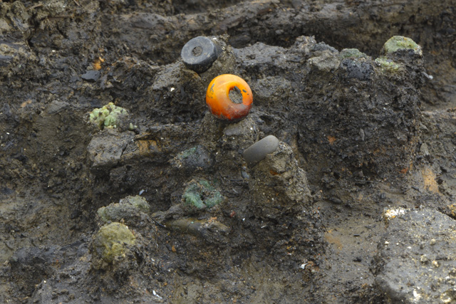 The positioning of beads at the site seems to indicate that some would have formed composite necklaces of amber, glass, stone and jet.