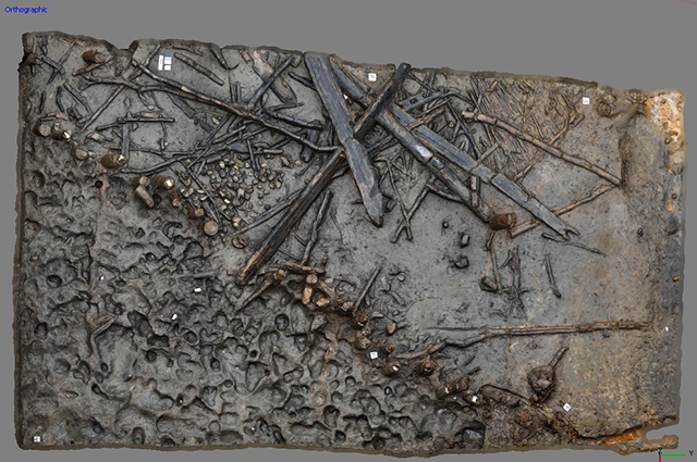 A 3D model of one area of the Must Farm pile-dwelling settlement showing some of the timber debris, the palisade and an area of preserved footprints.