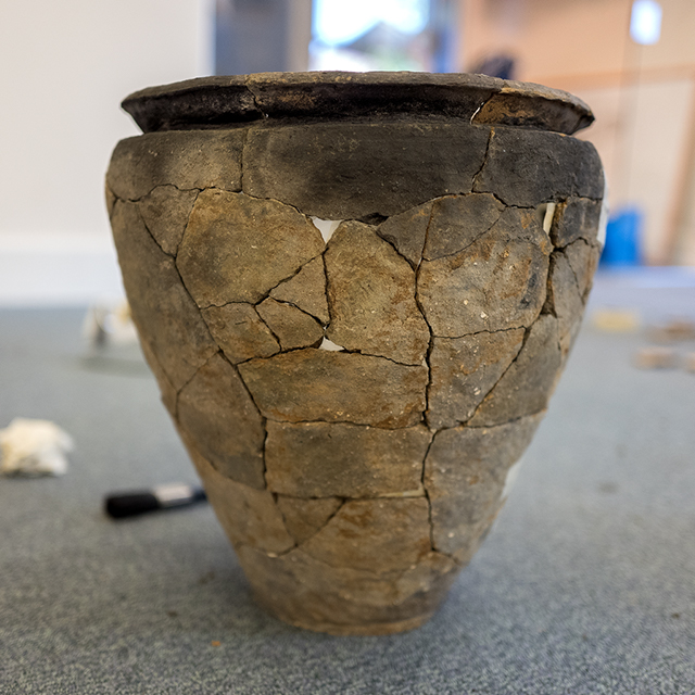 A large coarseware vessel refitted from broken sherds during post-excavation.