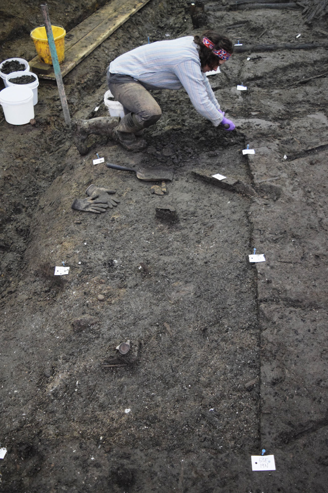 Excavating the occupation deposit that sits underneath the wood mass