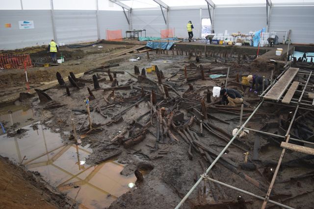 Working shot showing the Central Eastern Area. The large, dark timbers to the left of the image are posts from the causeway. In the centre of the image, to the left of the white sample buckets, you can just make out the interior post ring from RH 2.