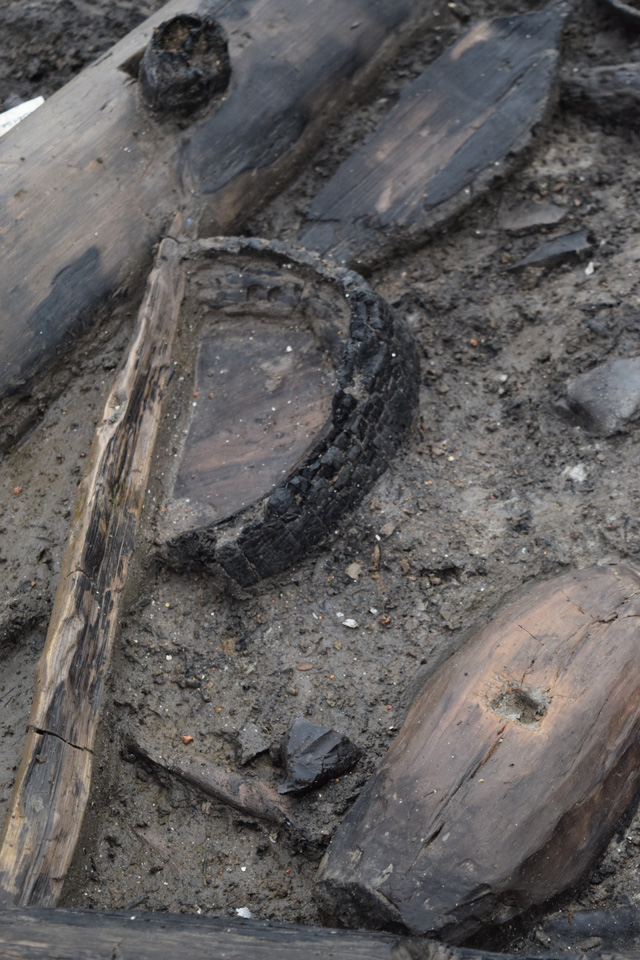 Wooden bucket base in situ within the occupation deposits of roundhouse one.