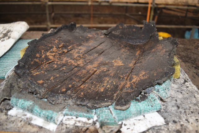 Characteristic wooden platter made from one piece of carved wood, recovered from the wood mass deposit.