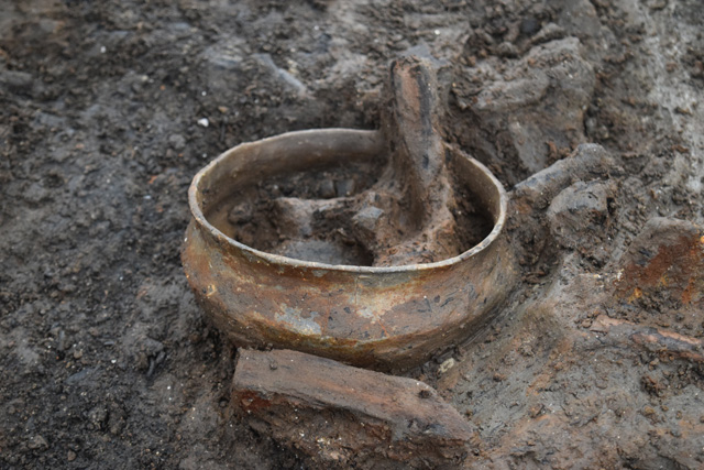 A typical fineware bowl in the process of being excavated.