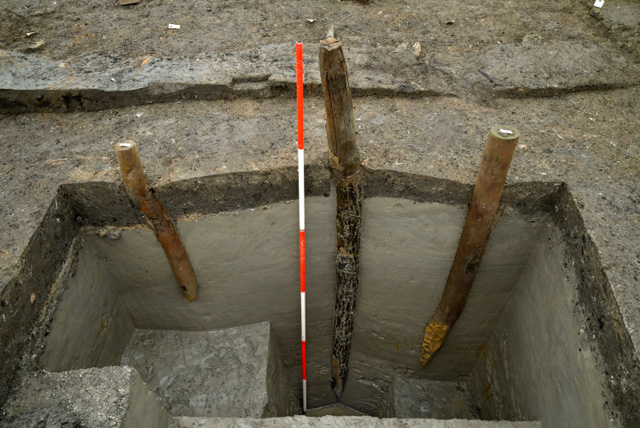 Image showing an investigative slot into the posts related to Roundhouse One. The largest post in the centre is oak and belongs to the outer ring of posts from the structure.