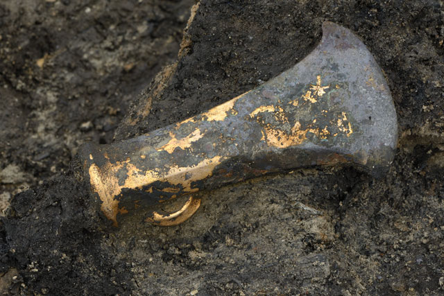 Late Bronze Age socketed axe found in the occupation material that fell into the river when the stilted house above collapsed.
