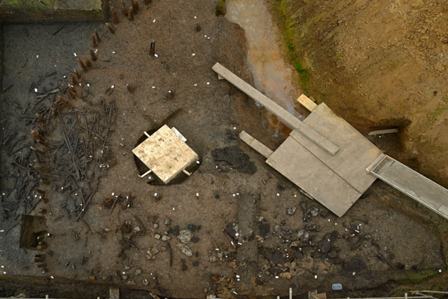 Recent image taken showing an overview of the Western Area of the excavation. The large wooden box contains the wheel discovered in February, while it is waiting to be removed.