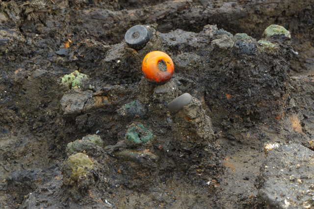 We've done our best to share the most interesting finds and discoveries from the site, such as the remains of this necklace, consisting of jet, amber and glass beads.